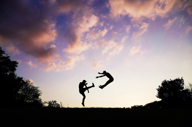 2-people-doing-karate-during-sunset-62376